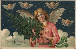 A Merry Christmas - an angel in the sky, holding Christmas tree