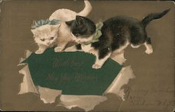 "2 illustrated kittens tearing up gift wrap to find the greeting ""With best New Year Wishes"" beneath"