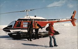 Landing a Helicopter on the Moving Ice During One of the Tours to see The Seals on the Icepack in the Gulf of St. Lawrence, Canada