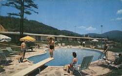 Howard Johnson's Motor Lodge and Restaurant; People sit around pool watching boy dive
