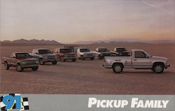 Pickup Family Seven Pickup Trucks Parked with Mountains in the Background