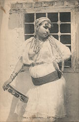 """Mauresque"" Moorish Topless woman with head scarf, necklace, lace dress and tambourine"