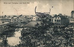 A river lined with scrub and houses Postcard