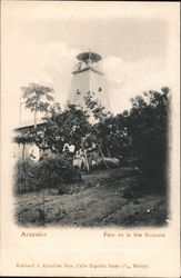 Tow men standing in front of a lighthouse