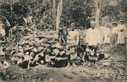 Natives Standing by a Pile of Rocks