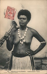 A Pacific Islander woman wearing a shell necklace and grass skirt holding a cudgel