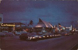 Scene at Night Along Motel Row Postcard