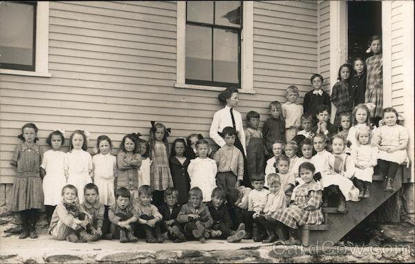 Children Lined Up in Front of a Schoolhouse School and Class Photos