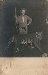 Man with gun, standing with tiger