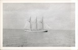 Four Masted Sailboat on Water