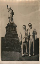 Two Men Standing in Front of the Statue of Liberty Postcard
