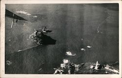 Aerial view of lighthouse and small islands Postcard