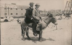 Two Men Riding a Donkey