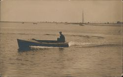 Man in Speedboat on Water