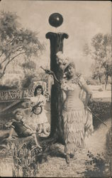 Letter I A Woman and Two Children Standing by a Body of Water Postcard