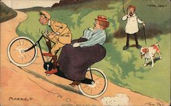 A thin man peddling a bicycle up a hill with a large woman on the back of the bike. Postcard
