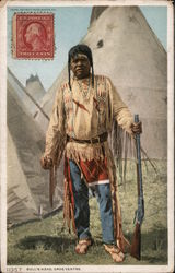 Bull's Head. Gros Ventre. - Native Man Holding Rifle, Tepee in Background