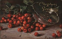 A bowl upturned on a table and cherries scattered about