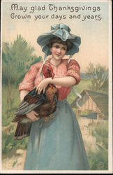 Woman holding a turkey