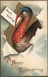 "Turkey breaking through paper holding ""hearty greetings"" card"