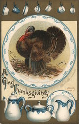 """A Glad Thanksgiving"" - Turkey w/ various pieces of blue-trimmed china"