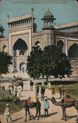 Indian men and camels in front of large building Postcard