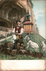 Boy sitting on a rock with two goats Postcard