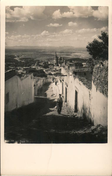 Boy on the Street, San Miguel Arcangel in the Distance San Miguel de Allende GT Mexico