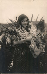 Woman With an Armload of Flowers in a Field of Iris Postcard
