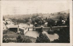 Small town with bridge over a river Postcard