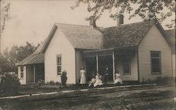Family in front of House Postcard