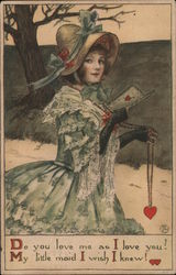 Girl in a bonnet holding a Valentine's Day card and a necklace with a heart on it