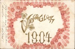 Viel Gluek 1904 gold font with clovers has pink flower ring around words Postcard