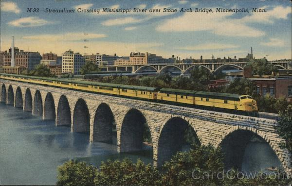 M-92- Streamliner crossing Mississippi River over Stone Arch Bridge Minneapolis Minnesota