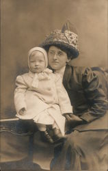 Studio portrait of woman and child