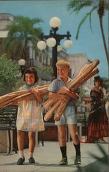 Two Children with Armloads of Crusty Bread Postcard