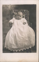 Baby in Wicker Chair Postcard