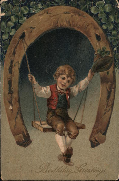 Birthday Greetins - Little boy on a swing w/horse shoe and clover