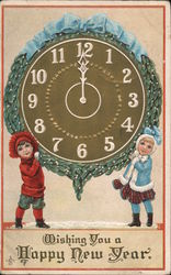 Boy and Girl holding overlarge clock set for 12 midnight Postcard