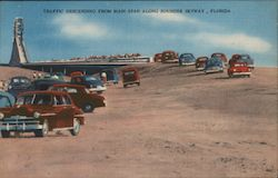 Traffic descending from main span along Sunshine Skyway Postcard