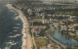 Air view showing hotels along Ocean Front and Lake Pancoast at Miami Beach, Florida Postcard