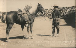 President T. D. Taylor of the Round Up and First Prize $350 Saddle Postcard
