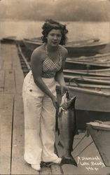 A Diamond Lake Beauty (Woman with fish) Postcard
