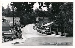 Business section, car lined street Postcard