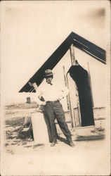 Man at Oil Field Camp with Cigar Postcard