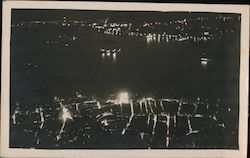 View of City and Harbor at Night Postcard