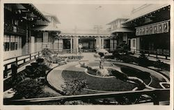Japanese courtyard garden with fountain Postcard