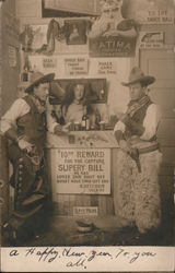 Two cowboys with guns, chaps, hats at fake bar, spittoon. Postcard