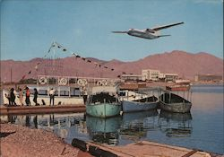 "Arkia's jet prop ""Herald"" landing at Eilat on the Red Sea"
