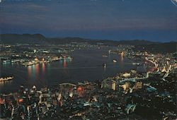 Bird's eye view of Central and Eastern Districts of Hong Kong with Tsimshatsui, Kowloon, at night Postcard